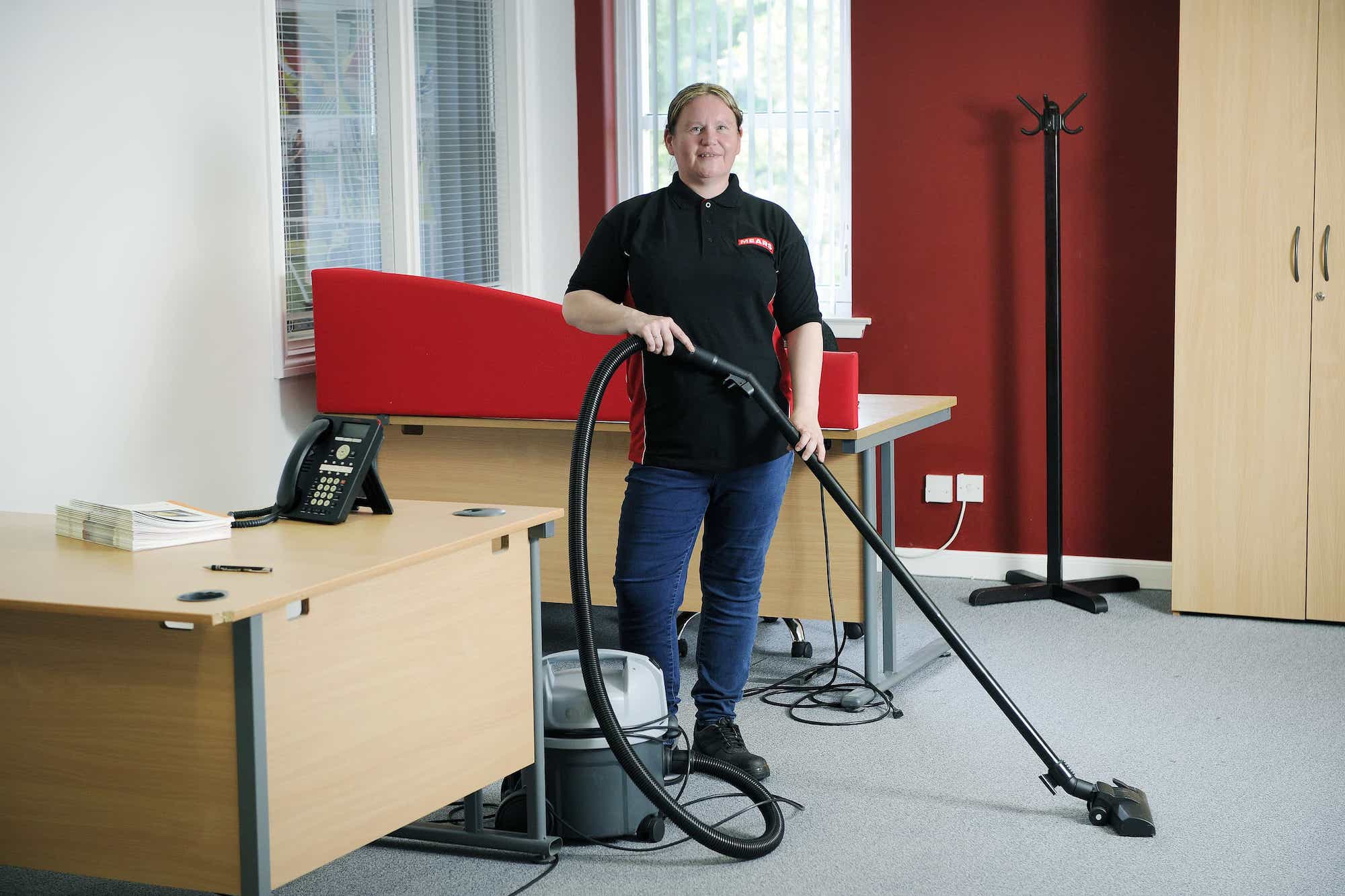 Mears colleague from Facilities Managing, cleaning a school in Scotland