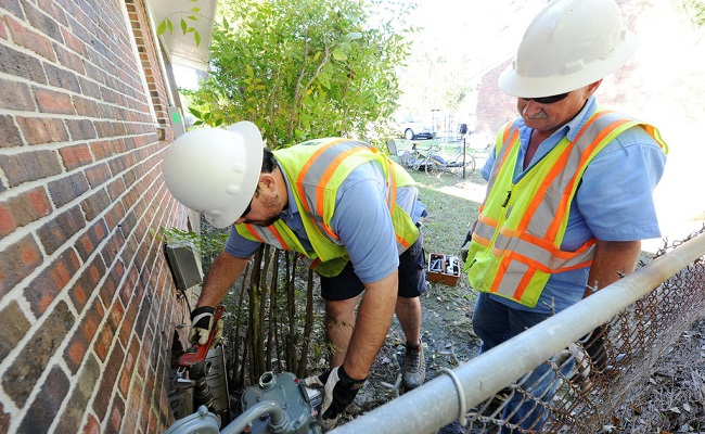 Workers replace meters that were damaged by Hurricane Matthew.