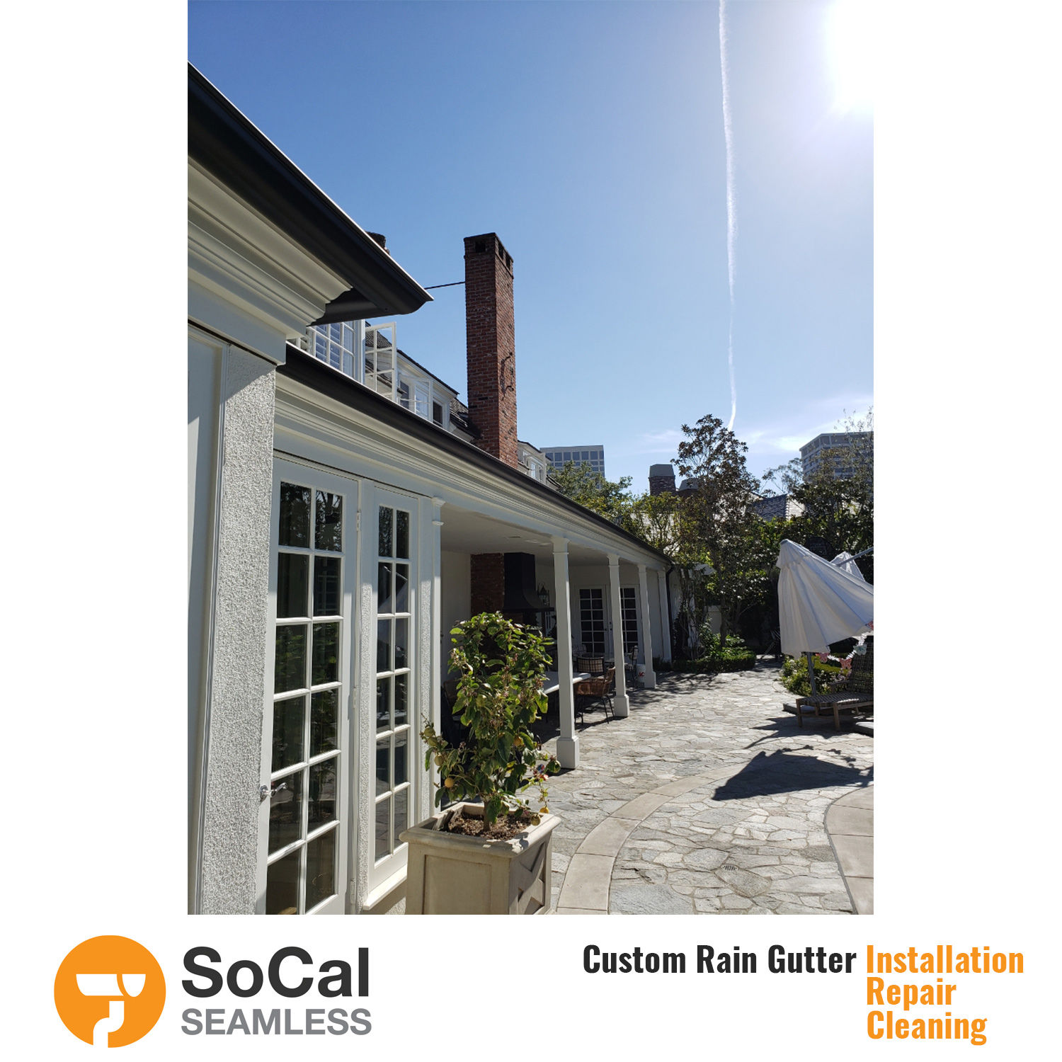 large patio and home with half round black rain gutter installation socal seamless