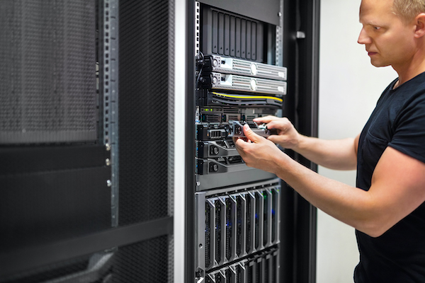 Image of man at a server rack