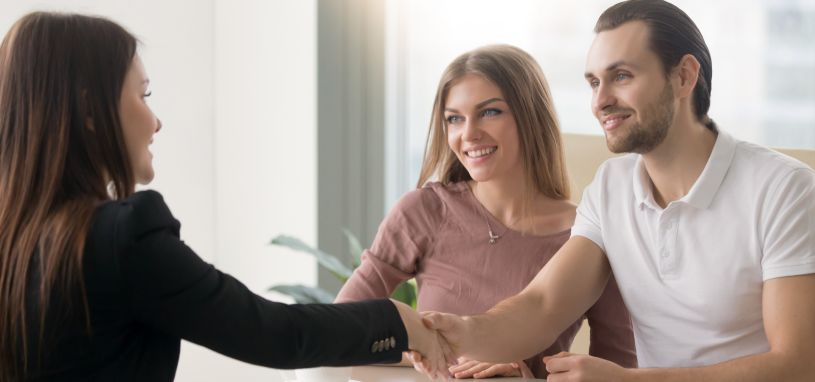 a young couple having a meeting with a property manager