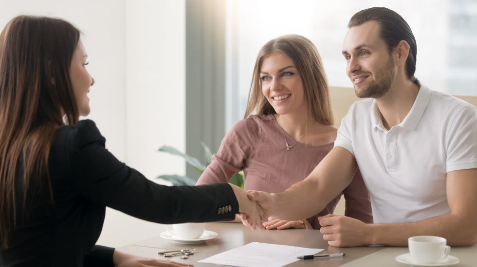 young couple meeting with a property manager
