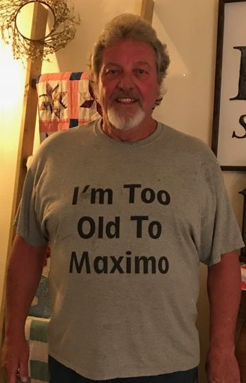 "IPSC Employee Wearing ""I'm too old to Maximo"" shirt"
