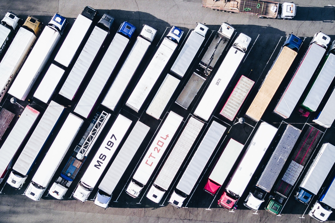 photo of a number of trucks in a parking lot