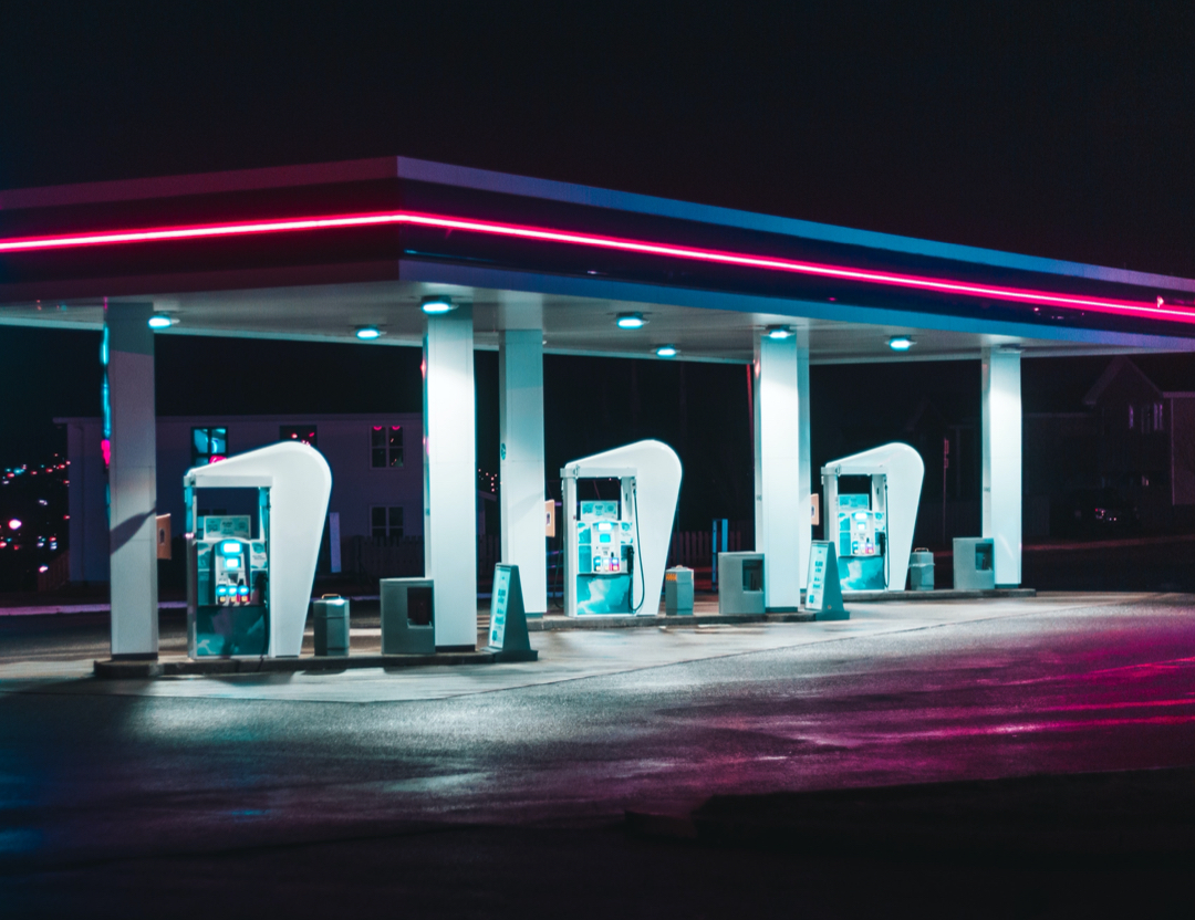 photo of a gas station at night