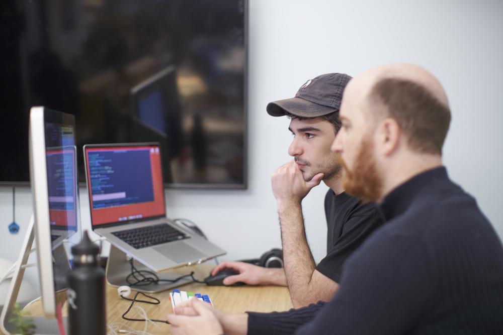 Hologram engineers working at their desks