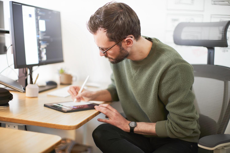 Hologram designer sketching on an iPad at their desk