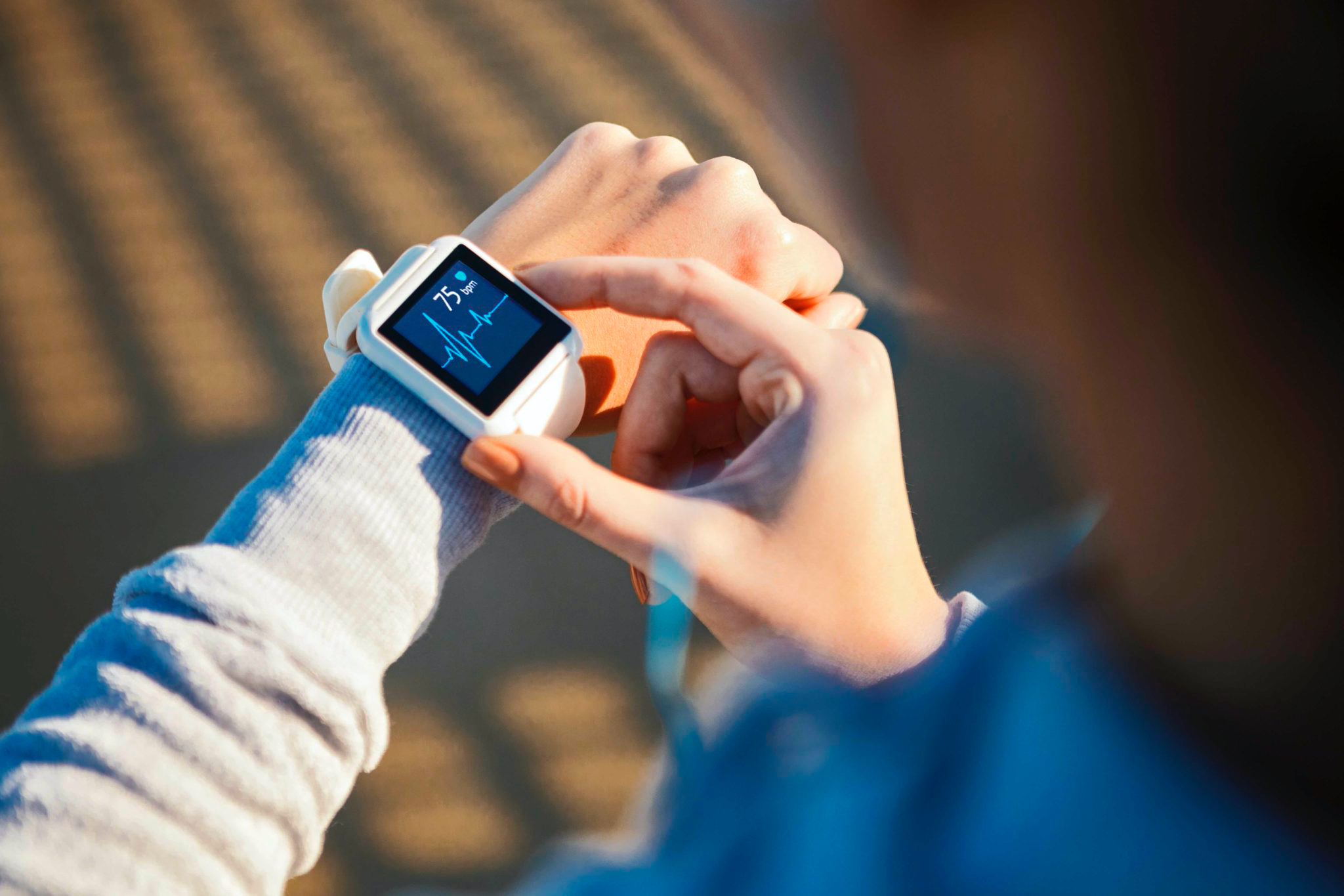 phot o of a women checking a health wearable watch