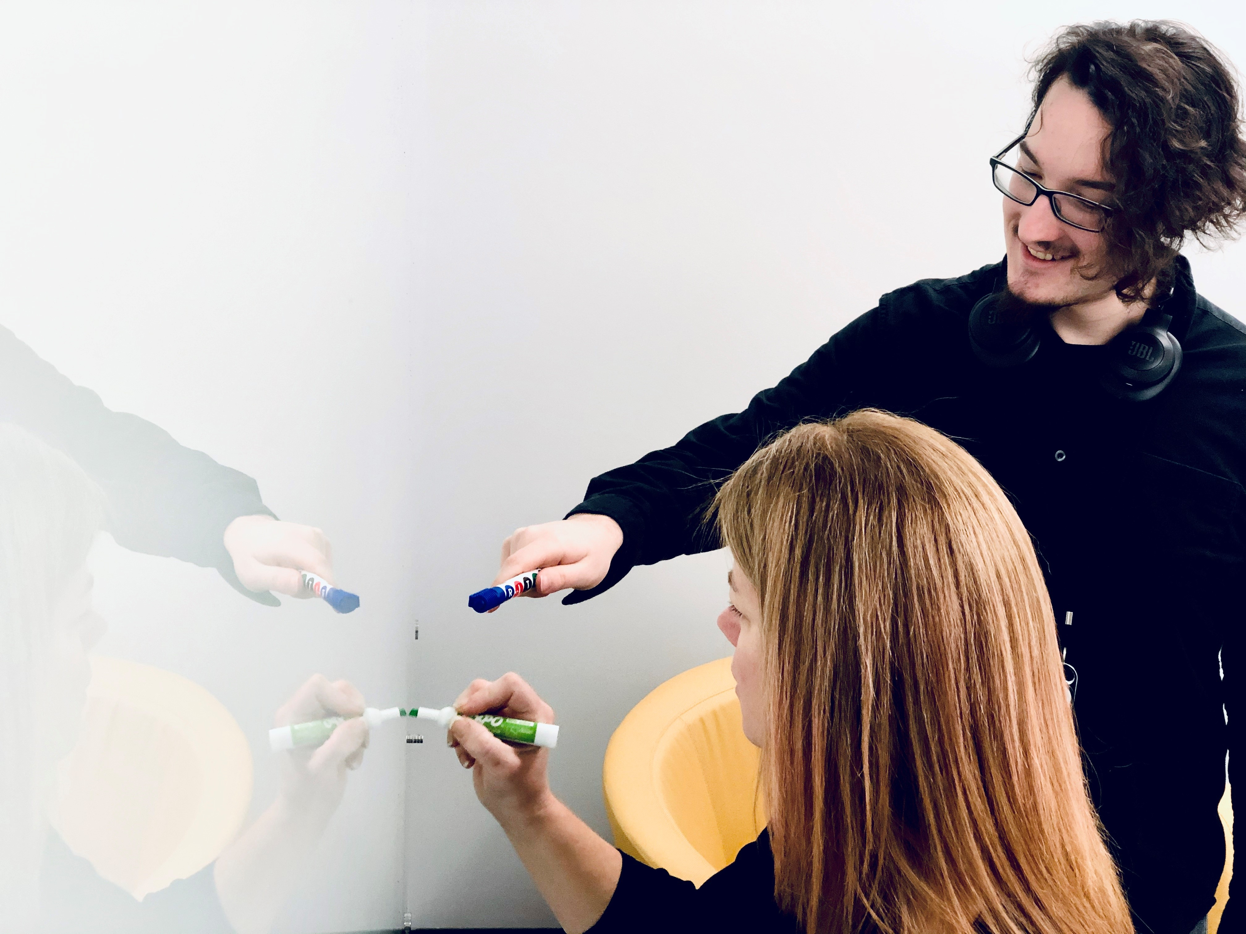 Group of employees collaborating on the whiteboard