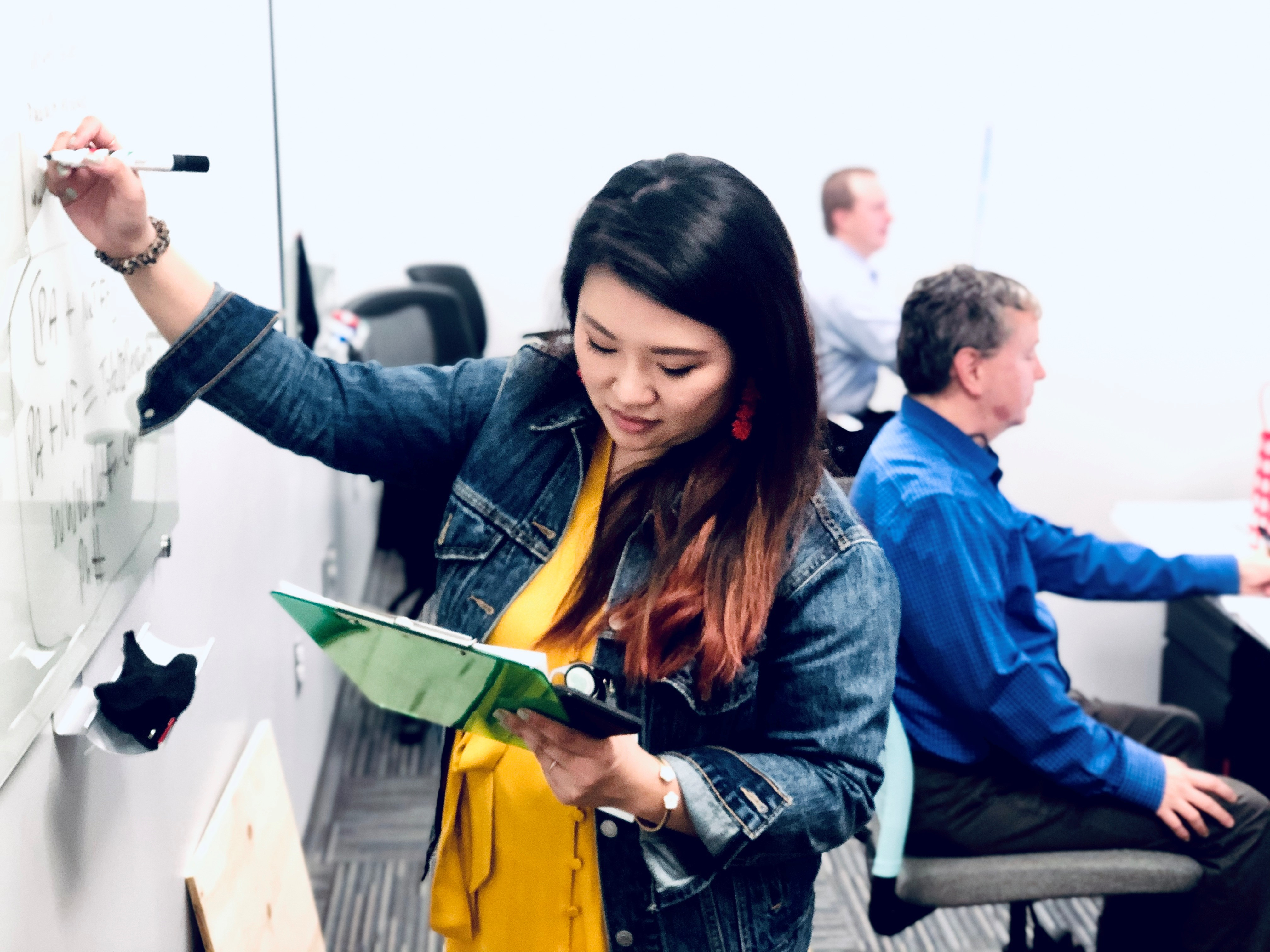 Net Friends team member Emily sharing ideas on the whiteboard