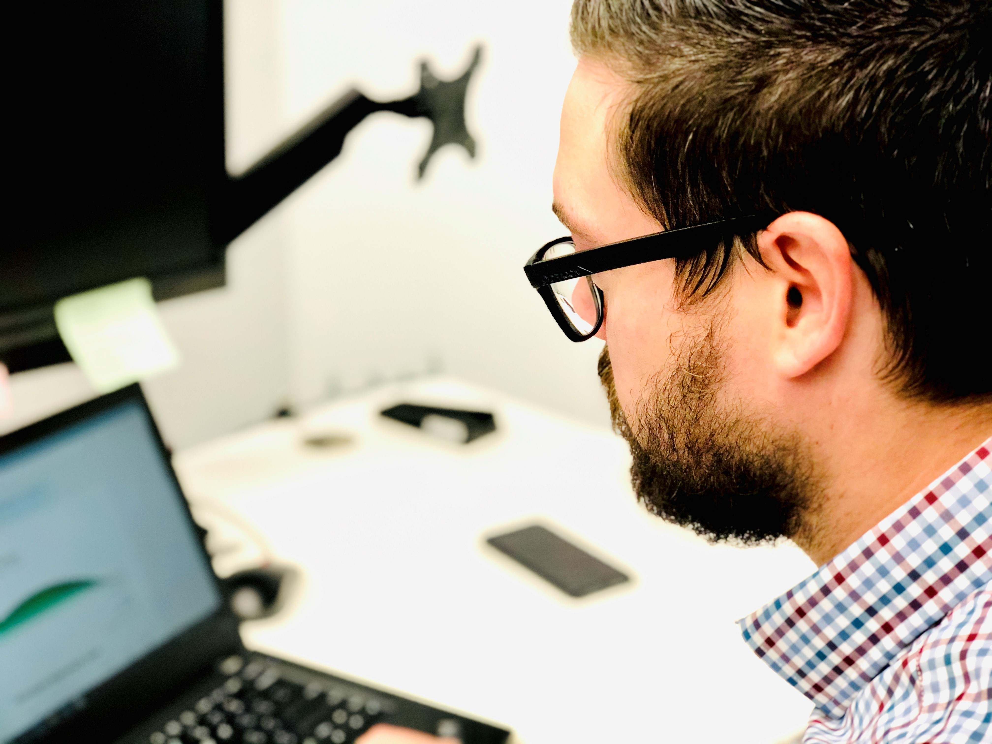 Net Friends team member Cody doing work on his laptop