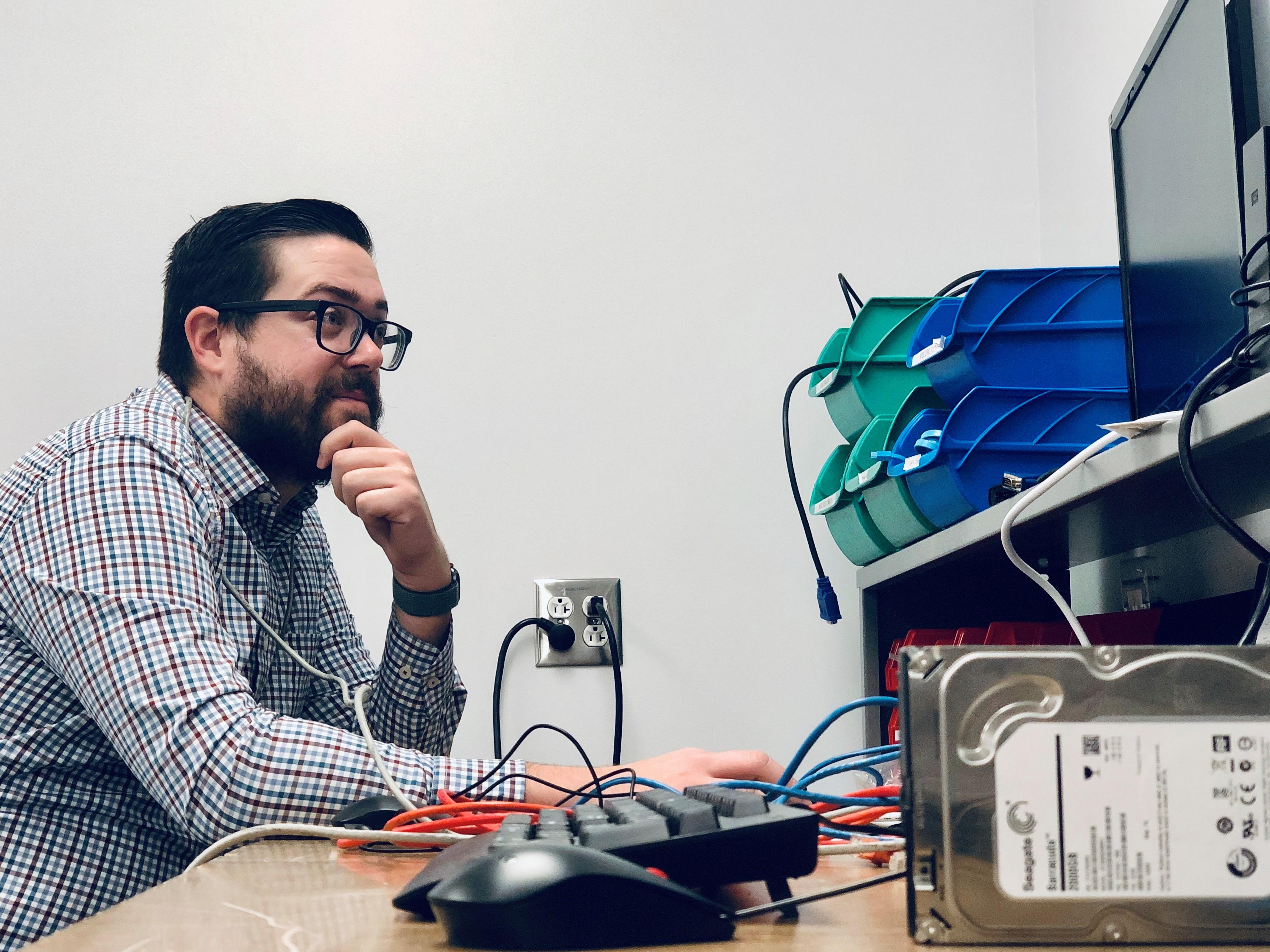 Man working on a desktop computer