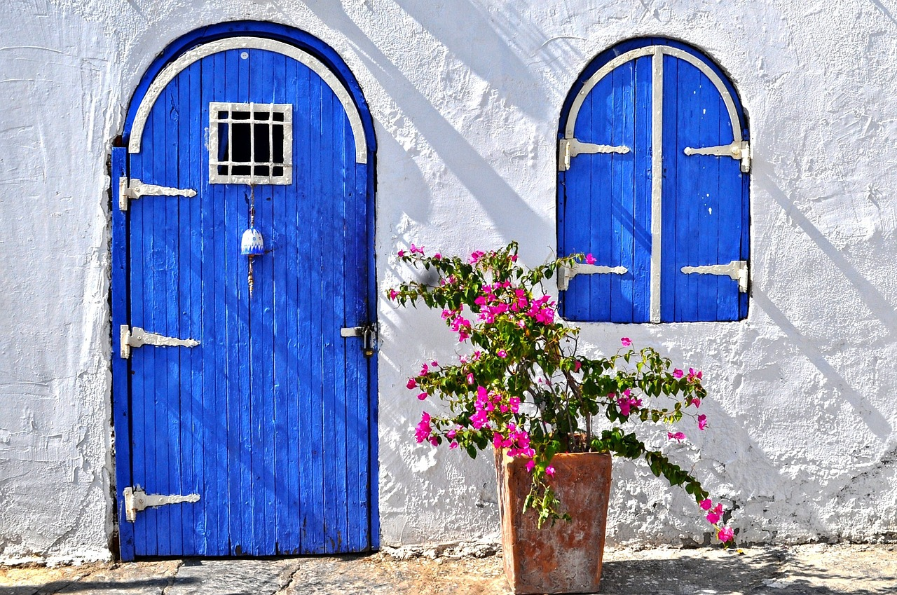 White wall with Blue door and window shutters