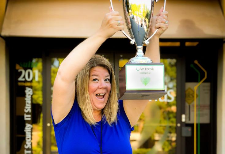 Net Friends team member Rachel with a trophy