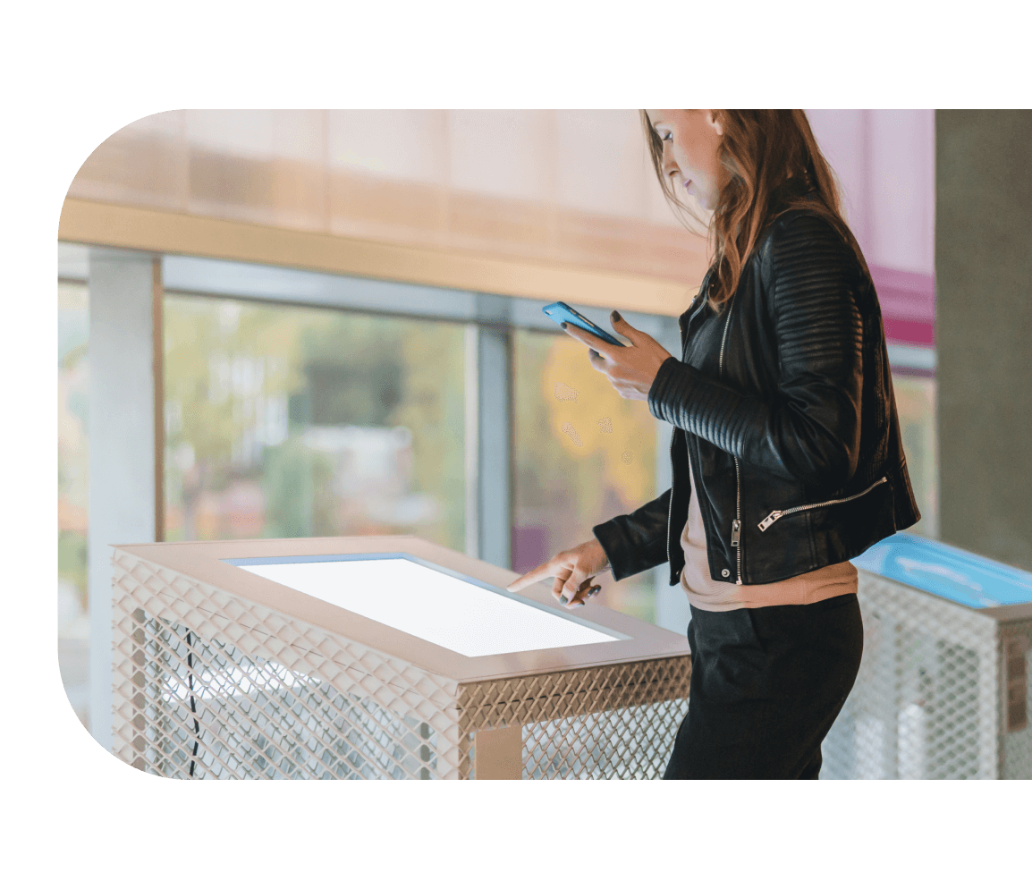 Woman using digital signage