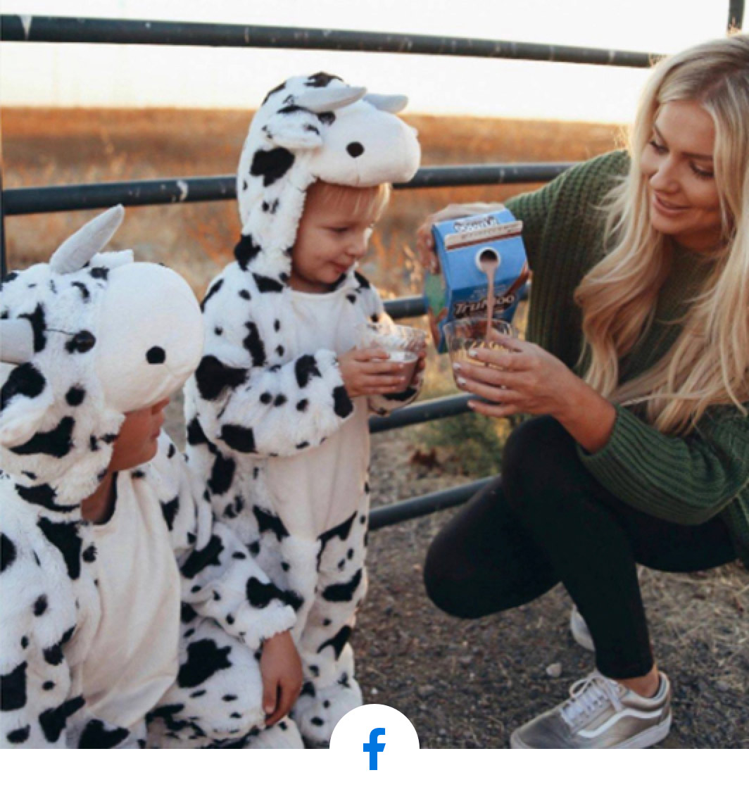 mom pouring milk for kids in cow costumes
