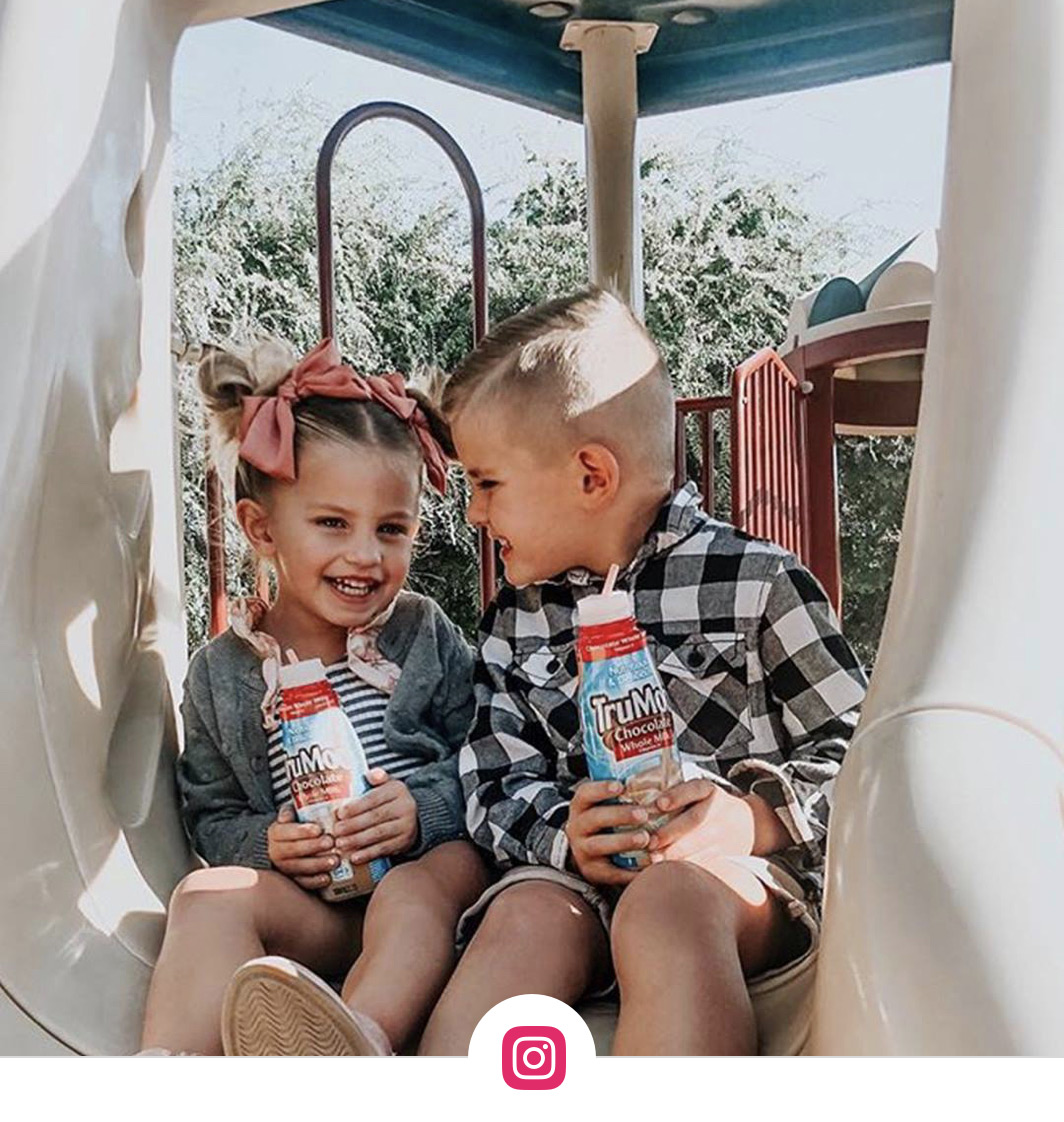 boy and girl holding trumoo milk