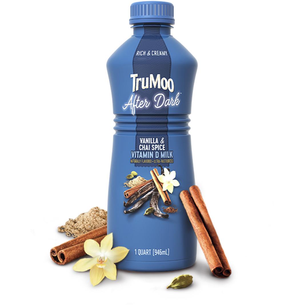 blue after dark bottle with cinnamon stick and vanilla flower