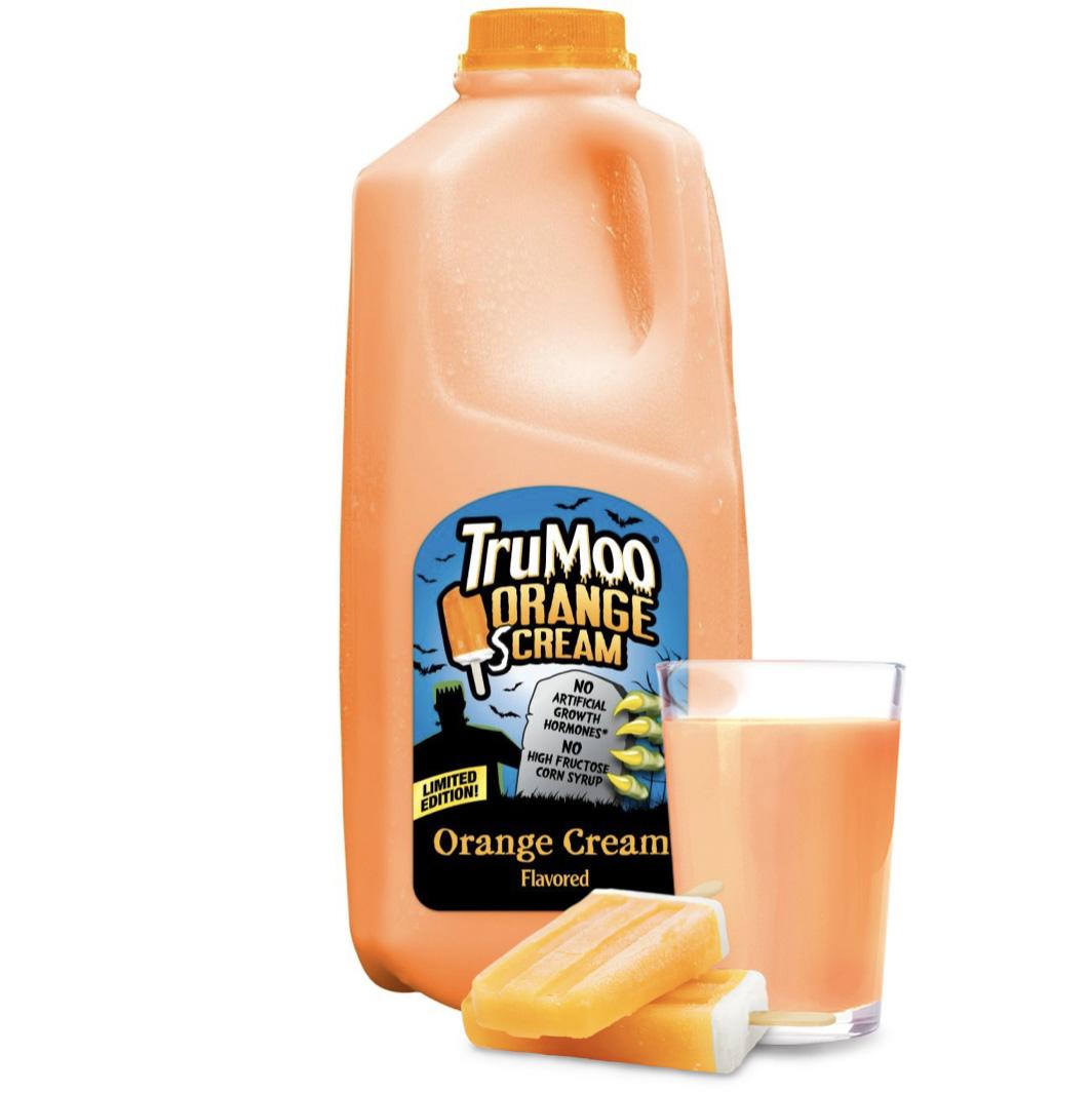 orange half gallon bottle with glass and orange