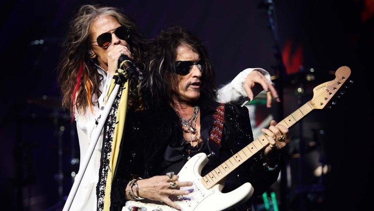 Picture of the band Aerosmith performing in concert