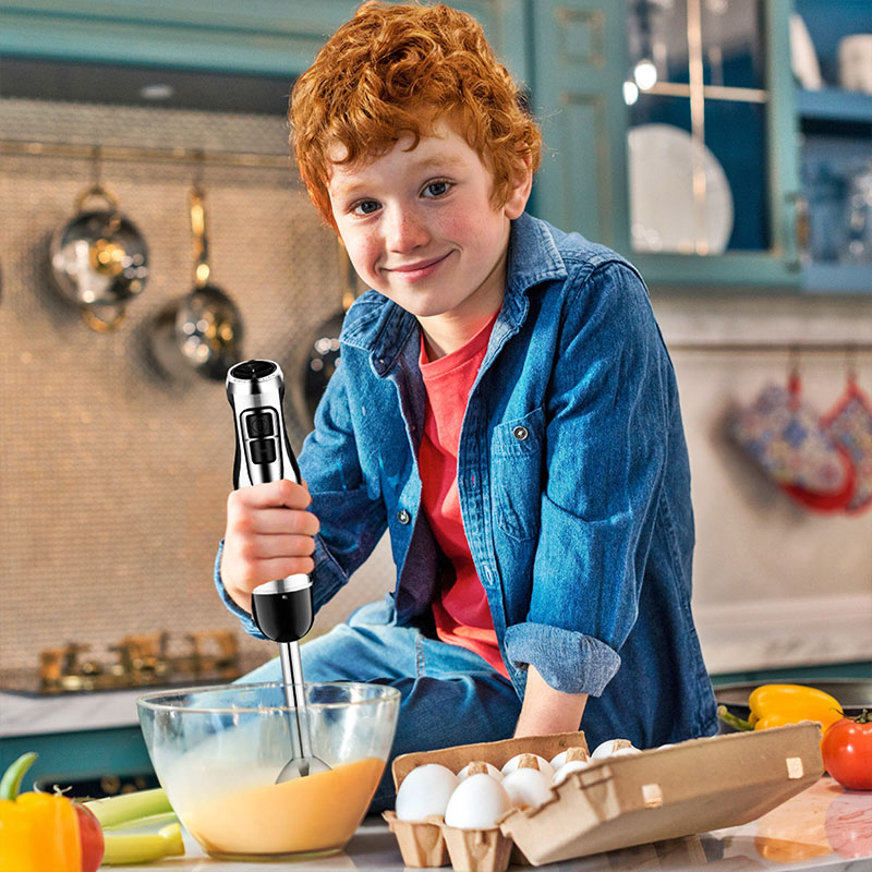 small kid using the hand blender