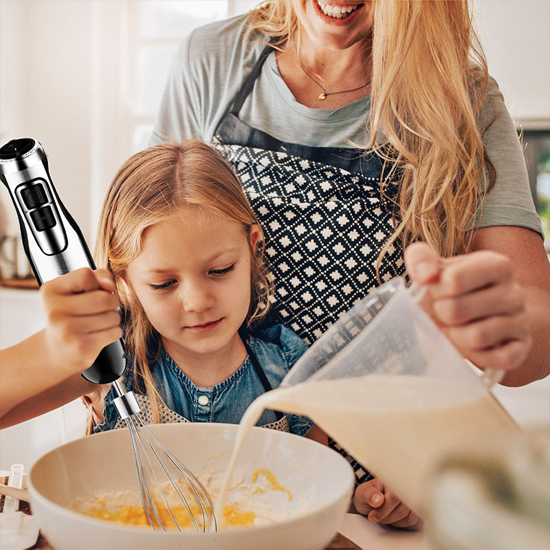 mother and daughter using hand blender
