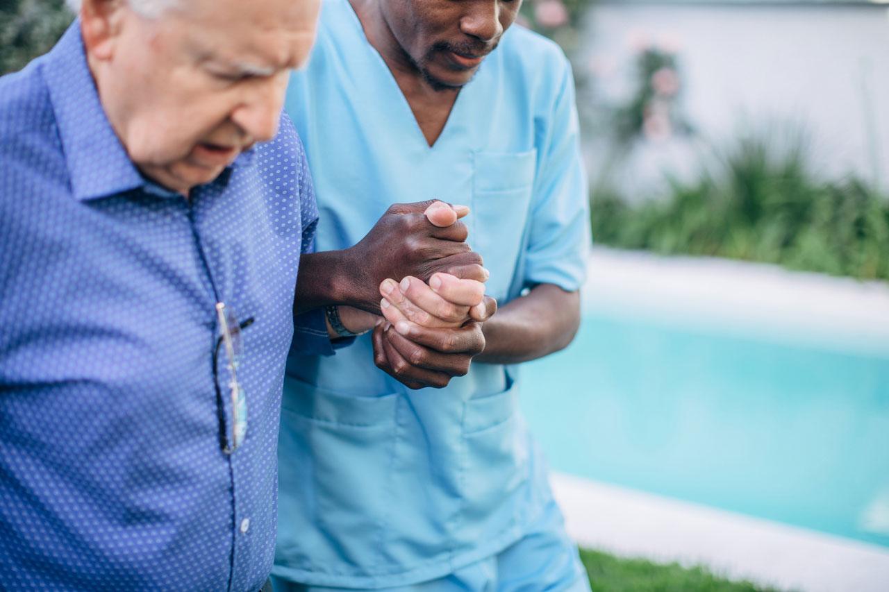 CNA assisting an older man