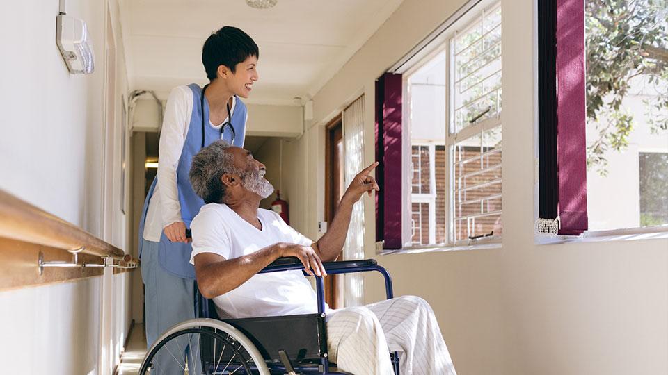 Caregiver using key CNA personality traits kindness and empathy