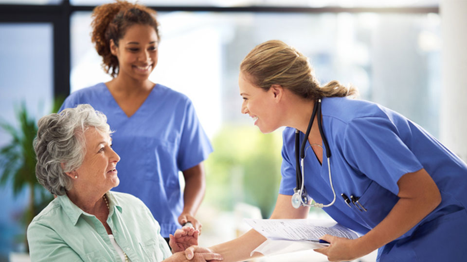 CNA assisting older person