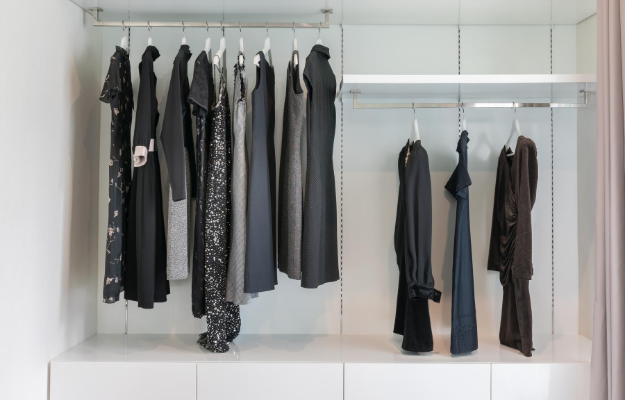 A wardrobe full with black clothes | How To Start A Capsule Wardrobe To Help The Environment