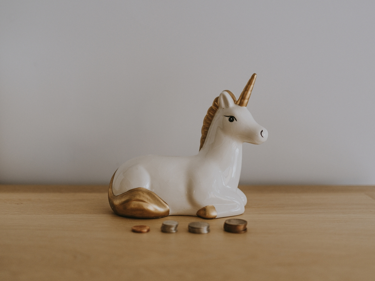 white unicorn with coins