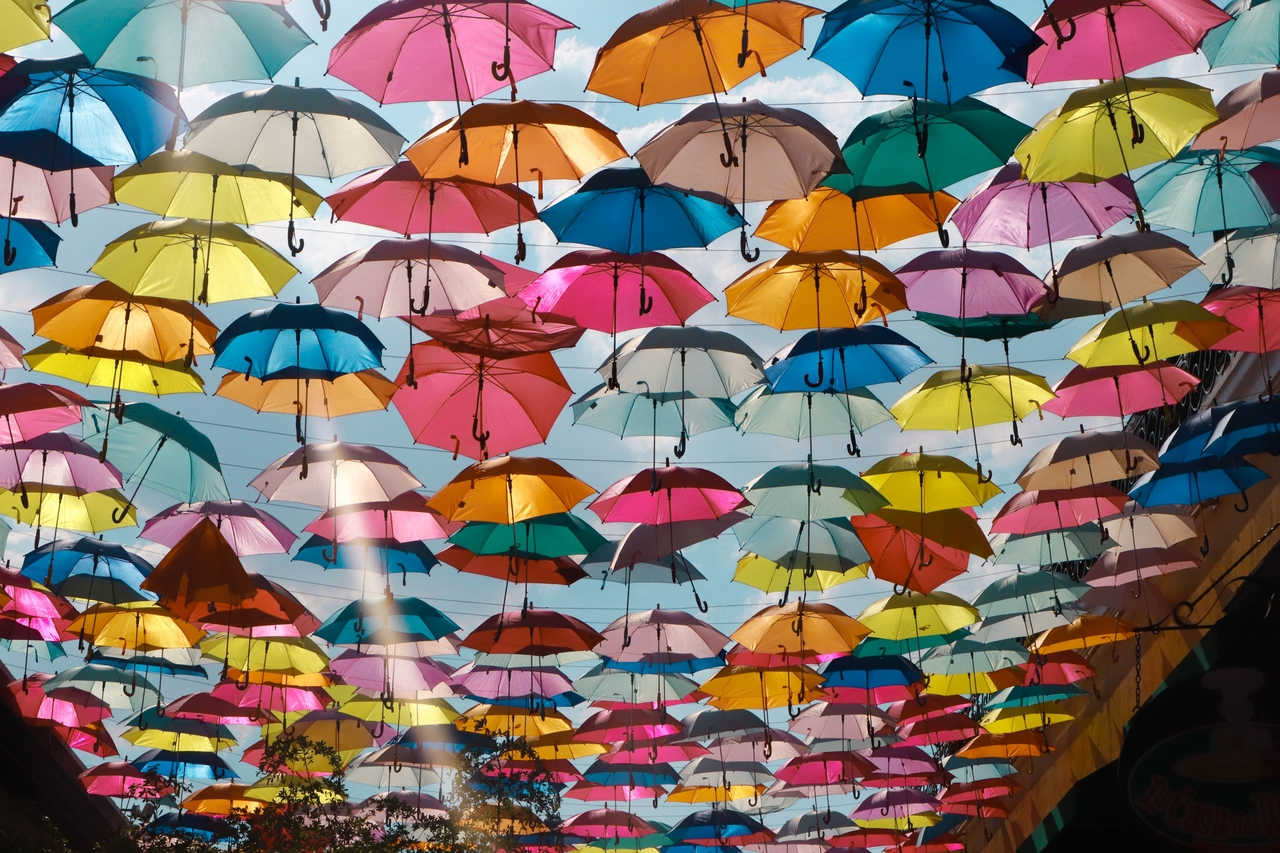 colorful umbrellas above street