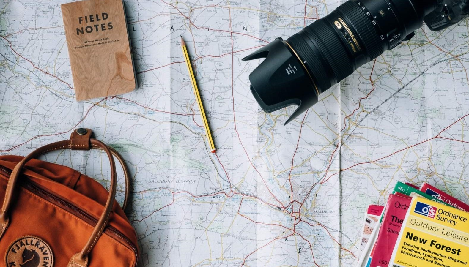 Travel euipment with camera, map, backpack