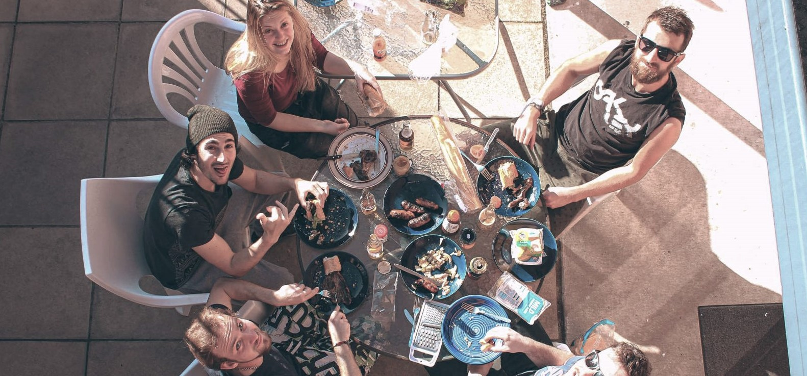 Happy people having a bbq at a hostel