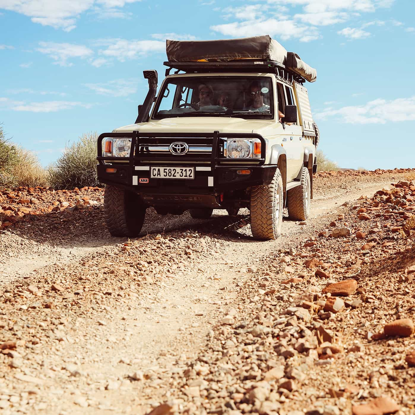 Closeup of Safari Drive Land Cruiser on a rubble back road in Nambia