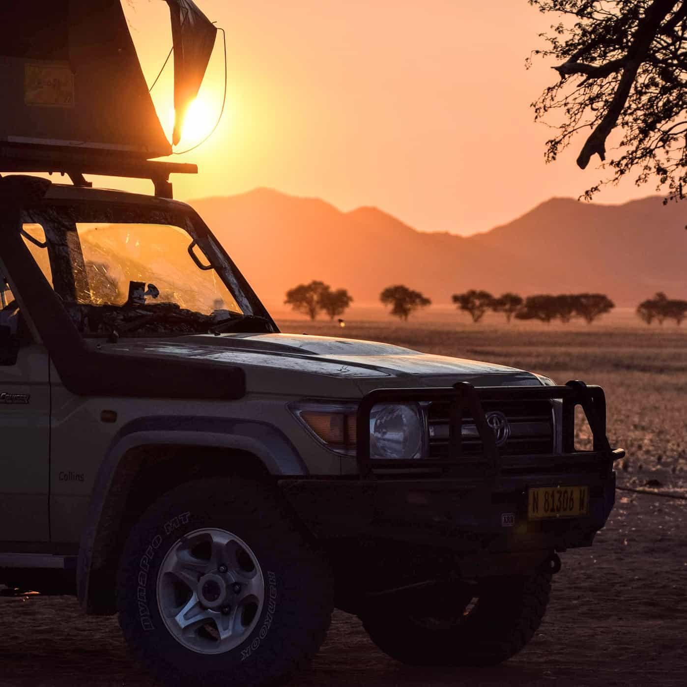 Safari Drive Land Cruiser closeup on an African plain at sunset