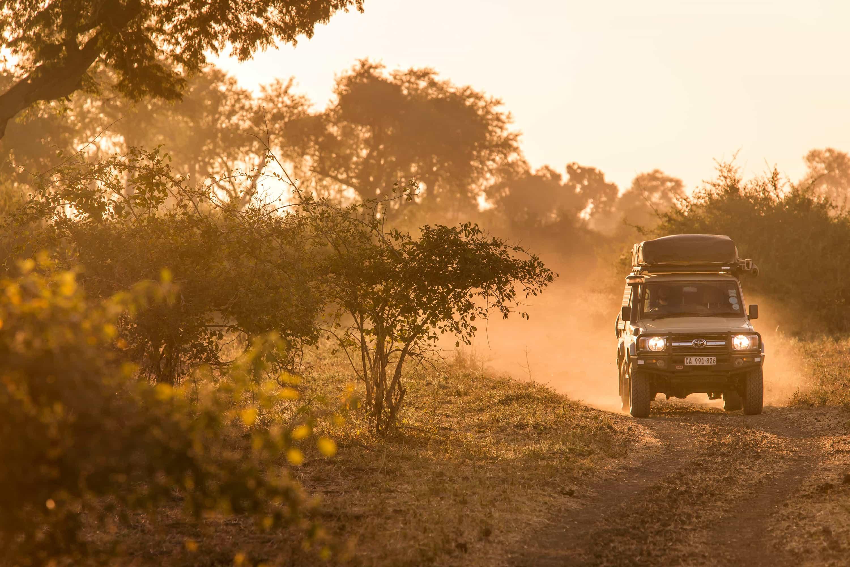 Safari Drive Land Cruiser driving on a dirt road in Namibia
