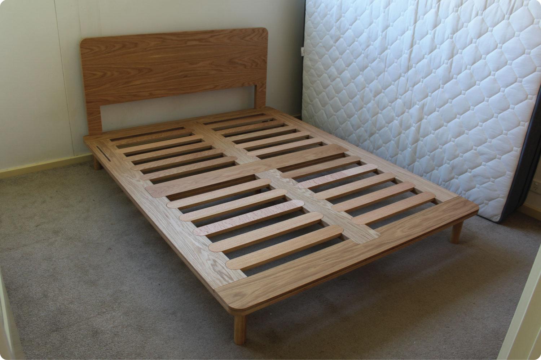 Eva timber bed frame complete in room