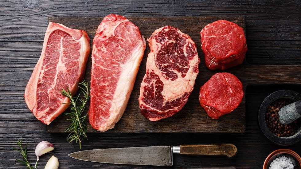Variety of Angus Prime meat steaks, including Blade on bone, Striploin, Rib eye, and Tenderloin fillet