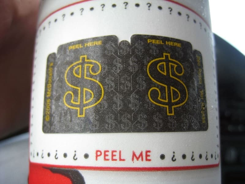 McDonald's Monopoly game pieces on a McDonald's drink cup