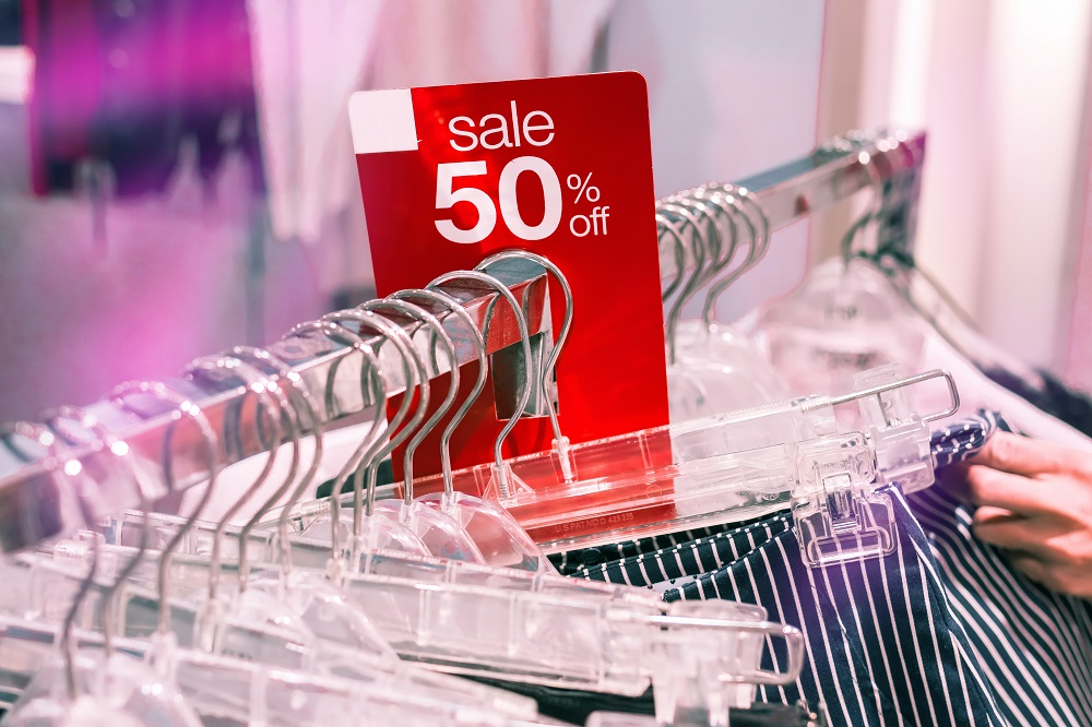 Sale tag on a rack in a clothing store