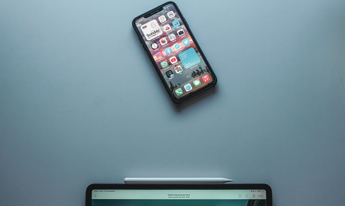 An iPhone and an iPad on a blue background