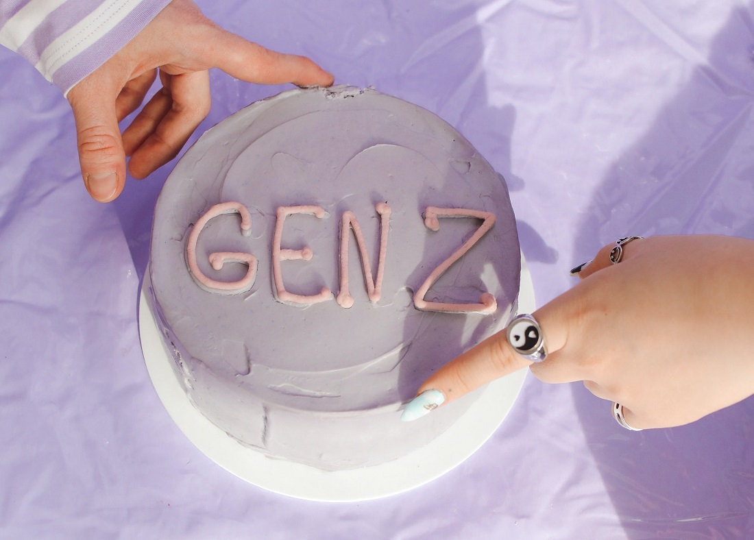 A pink cake with 'GEN Z' written on top in icing