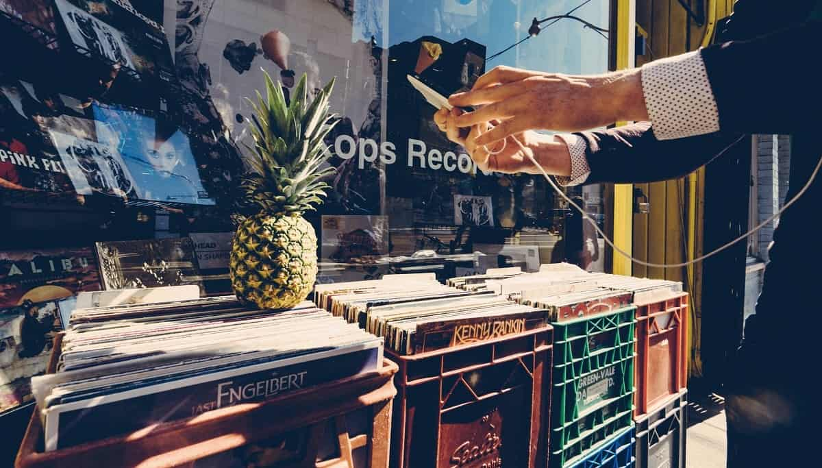 A man outside a record shop in Brooklyn, New York