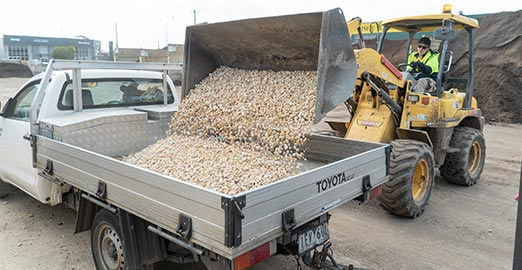Serving customer with pebbles building supplies
