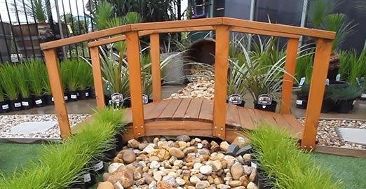 Landscaping showcase with bridge and pebbles