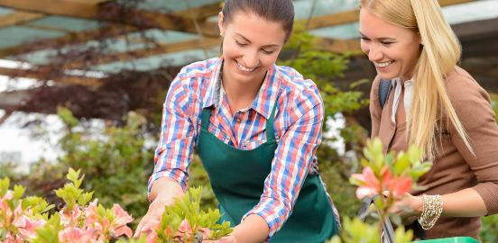 garden centre worker helping a customer