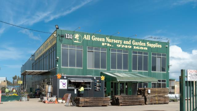 All Green Nursery Building and Sign