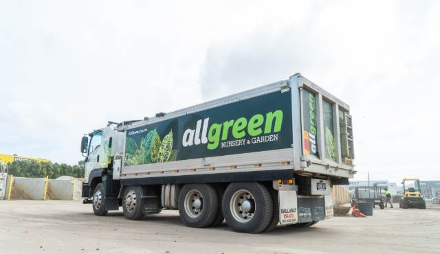 All Green delivery truck