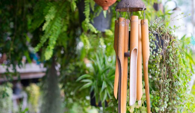 wooden wind chime hanging in garden